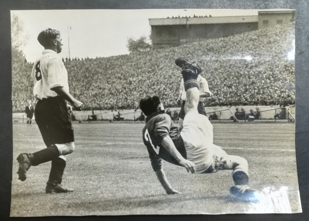 Swiss player Rudolf Gyger clears the ball front in front of Raich Carter, as they go on the beat England 1 - 0 in a friendly in 1947 in Zurich.