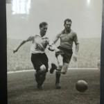 Tom Finney takes on Swedish captain Erik Nilsson at Highbury, November 1947.