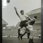 Bell of Chesterfield FC clears the ball away from Eddie Baily of Spurs, Christmas Day 1947.
